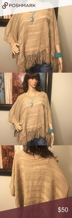 NWT Woven Heart Poncho/Sweater Size Large Woven Heart * New with Tags * Size Large * Gorgeous Tan Color * Fringe along the Bottom * Single Button Closure under the Arms * Soft * Pair with Jeans or Dress Pants * Easily go from Work to Play * 54% Cotton/46% Acrylic * Necklace and Bracelet are also Available in Other Listings  Visit @KidsCache for Kids Clothing  Visit my Hubby's Closet @MensStyleHouse for Top Brand Men's Fashion Woven Heart Sweaters Shrugs & Ponchos