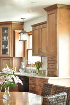 Spice glaze over cabinets. granite countertops I like the cabinet sitting on the counter and the appliance garage here.  e