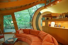 Harmonious: Geometric shapes, including the door to an outside deck, meet curved lines in ...
