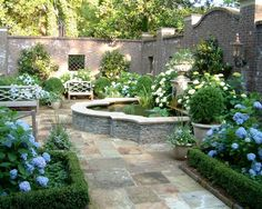 Love this walled garden/courtyard with beautiful plantings