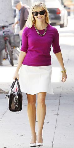 Street Style File: Reese Witherspoon was all smiles while out and about in West Hollywood in a fuchsia sweater styled with a white flared mini skirt, gold jewelry (including statement chain link necklaces), and white pumps. #InStyle