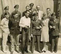 "The crew of the ""Hell's Angels"" of the Bombardment Group visits with the cast of To Have and Have Not during a war bond tour. Cast members present were Humphrey Bogart, Lauren Bacall, Hoagy Carmichael and Walter Brennan. by kristy Old Hollywood Stars, Classic Hollywood, Hollywood Glamour, Hoagy Carmichael, Bogie And Bacall, The Big Sleep, Great Love Stories, Humphrey Bogart, Star Wars"