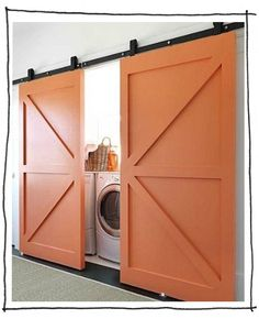 Beautiful barn doors keep this laundry room hidden from site. Barn doors are a definate in our soon to be home in the future. More and more loving the barn door look Hidden Laundry, Laundry Closet, Laundry Area, Laundry Rooms, Small Laundry, Basement Laundry, Garage Laundry, Concealed Laundry, Laundry Chute