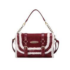 Pin Buckle Strap and Faux Fur Embellished Shoulder Bag ($65) via Polyvore