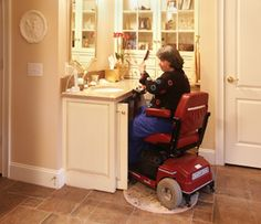 Sink height appropriate for wheelchair to fit underneath  - Doors open and tuck inside to access sink with close proximity  - Flat tile on floor under sink for wheelchair access