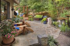 rustic-garden-container-plantings-garden-decor-adirondack-chairs-flagstone-water-feature-gregg-and-ellis-landscape-designs_3921-718x477