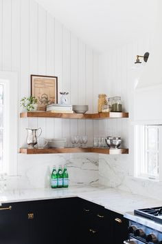 Kitchen floating chunky bookshelves Farmhouse kitchen with vertical shiplap walls and floating chunky bookshelves #Kitchen #floatingbookshelves #chunkybookshelves #shiplap #kitchen #kitchenshelves #chunkyshelves