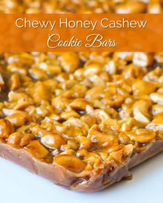 Honey Cashew Cookie Bars are chock full of crunchy cashews in chewy honey caramel on a brown sugar shortbread base, all drizzled in chocolate.