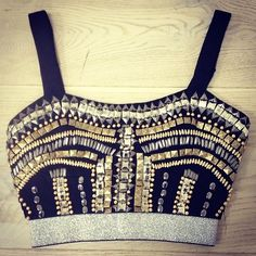 Beaded sparkly bustier top added to a high waisted skirt to make it a crop top without barring it all!