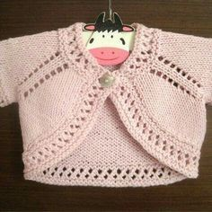 A super cute and quick-to-knit bolero with a pretty eyelet lace edging. A super cute and easy to knit bolero with a pretty lace top. Available with 2 other sweet boleros from the Sugar & Spice Bolero collection. Baby Sweater Patterns, Baby Patterns, Knitting Patterns Free, Knit Patterns, Free Knitting, Baby Sweater Knitting Pattern, Knitted Baby Cardigan, Amigurumi Patterns, Baby Girl Cardigans