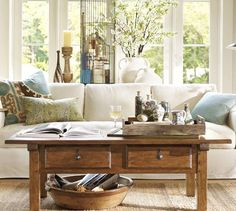 Interesting using a basket on the floor under the coffee table. Sawyer Coffee Table | Pottery Barn
