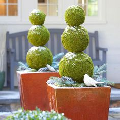 Moss covered balls stacked on stake