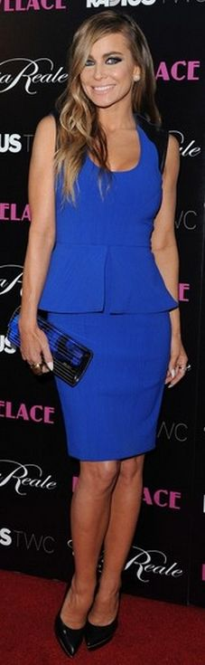 Who made  Carmen Electra's black peplum pumps, black platform pumps, and clutch handbag that she wore in Hollywood?