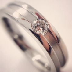 Men's diamond set 5mm wedding ring. Heavy weight band with machined channel, part satin finish and flat court profile.
