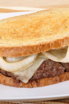 Classic Patty Melts Burger Recipe with sauteed onions & Swiss cheese on toasted rye bread.