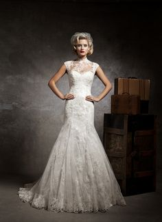 Justin Alexander wedding dresses style 8641 A strapless sweetheart mermaid lace and tulle dress over a beaded embroidery. Featuring a Mandarin neckline sleeveless lace and tulle jacket.