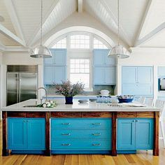 Painting cabinet doors varying shades of blue adds interest to your kitchen decor. | Coastalliving.com