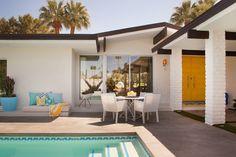 Concrete patio with brick border patio midcentury  with trina turk stucco exterior