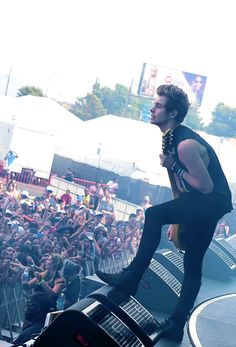 """"""" Luke Hemmings of 5 Seconds of Summer performs onstage during the 2014 iHeartRadio Music Festival Village. """""""