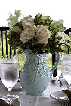 Find or paint vintage pitchers in your color scheme for centerpieces! Love it!
