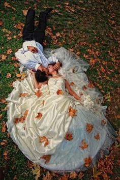 Bride and groom in grass and leaves by Dittekarina