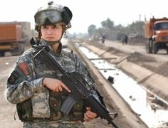 A woman in the military servings our country.