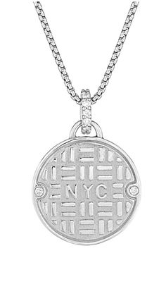Julie Lamb's NYC Manhole Cover in silver with diamonds!