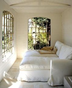 Two chaise lounges side by side in a sun room. For reading, early mornings, late nights, and storms. Keeping room.