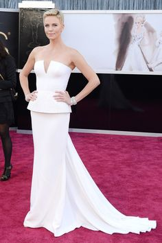 Charlize Theron accessorised her white Dior Couture gown with Harry Winston jewellery at the Oscars 2013