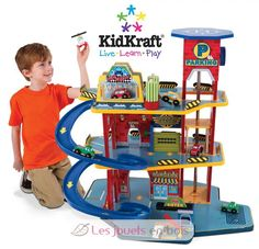Deluxe Garage Set by KidKraft Our Deluxe Garage Set is loaded with fun, interactive features and will keep kids entertained for hours at a time. This exciting wooden set gives kids so many options, theyll never run out of new ways to play! Toys For Boys, Kids Toys, Boy Toys, Giveaways, Toy Garage, Shops, Electronic Toys, Toddler Toys, Iphone