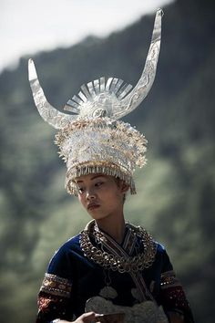 China, the Miao people, dressed in traditional native festival garments.