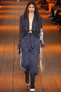 DKNY Spring Summer 2017 SS17 Ready-to-Wear collection - New York Fashion Week NYFW - Look 42: Taylor Hill wearing pinstripped blazer and papper bag pants