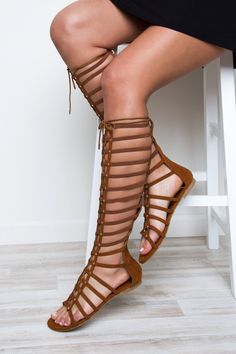 Embody a Greek goddess in these Hera Gladiator Sandals in Chestnut! Featuring a faux leather material with adjustable, tie brown laces that crisscross on the front of the leg for a customized fit. Gol