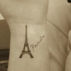 Cool tattoo of the Eiffel Tower, I'd love to put the year I went too, to remember when I went!!