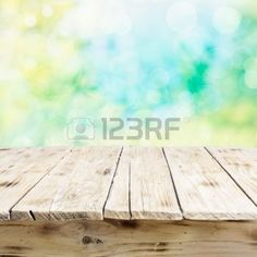 background wood: Empty old wooden table with a weathered rustic surface viewed low angle for product placement against a high key fresh outdoor sunlit background