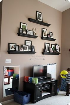Wall Shelves.. Great way to display photos without having to drill loads of holes in the wall and you can change them as often as you wish