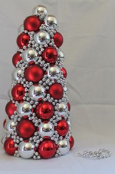Ornament tree:  use floral foam cone for the center and hot glue the ornaments onto it once you have removed their hanger part.  Cover up bare spots with garland beads, foil garland or wreath picks.  Make sure it is not top heavy.