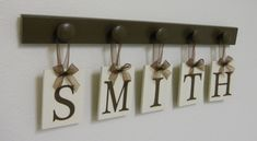 Wedding Gift - Gifts for Wedding Couple - Personalized Wall Decor for SMITH - Brown Wood 5 Peg Hanger - Unique Bride and Groom Gift. $25.00, via Etsy.