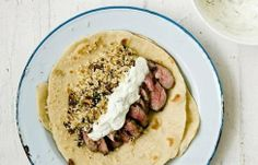 Turkish lamb flatbreads recipe - Encased in warm flatbread, the sliced lamb fillets are a remarkable mid-week meal that requires only a little bit of preparation. Lamb Recipes, Wrap Recipes, Clean Recipes, Savoury Recipes, Greek Recipes, Lamb Flatbreads, Turkish Lamb, Recipes With Soy Sauce, Marinated Lamb