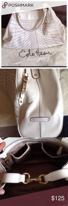 Large white leather Cole Haan bag. Perfect bag for Spring/Summer. It has two zipper compartments and two phone compartments. Pictures do not do it justice. 17long x 11 high. Minor wear on corners as pictured. Does not take away from the bags beauty.  Reflected in price. Cole Haan Bags