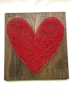 "Red Heart String Art - 12"" x 12"" - Nail and White String Art - Handmade - Made to Order - Ready to Hang with Hardware - Home Decor - Wall Art. This beautiful string art is made by me in my home. I start by milling the wood, sanding, then staining the wood. Once dried, I pick a pattern, pound the nails in and tie the string to make this amazing artwork. The popular wood is stained in dark walnut and measures approximately 12"" wide by 12"" tall by 2"" deep. This artwork is made in a smoke…"