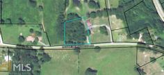 1.28 acre wooded building lot on paved road.