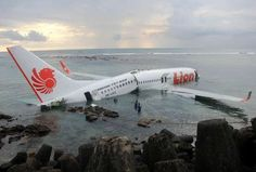 This handout photo released by the Indonesian Police on April 13, 2013 shows a Lion Air Boeing 737 submerged in the water after skidding off the runaway during landing at Balis international airport near Denpasar. An Indonesian plane carrying more than 100 passengers broke in two after missing the runway at Bali airport on April 13 and landing in the sea, leaving dozens injured but no fatalities.