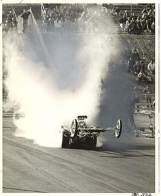 I love this picture!  Miss those front engine dragsters!!!!