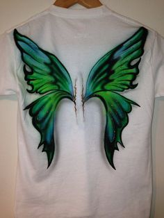 Airbrushed Fairy Wings Tshirt by MpressArt on Etsy, $20.00 I actually thought it was a pair of play wings!