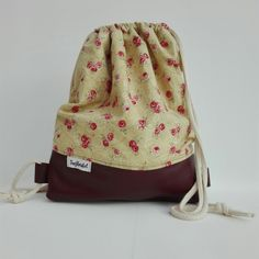 Handmade Backpack with red leather. For sale at DaWanda