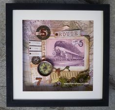 Large shadow box with an old card of a train. Decorated with metallic elements, wooden items and papers