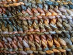 This scarf is good for stretching a little yarn a long way, and is ridiculously easy and quick (hence the name). It shows off the texture of thick-and-thin yarn very well. It looks the same on both sides, no wrong side, and has a little more structure to it than a traditional drop-stitch scarf. It's also surprisingly warm and cozy, given how open it is.