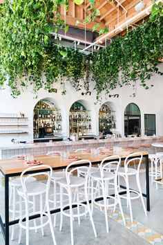 The design for the restaurant, which opened in April 2018, highlights original elements of the space with white-washed walls and wood furnishings to complement the old warehouse.
