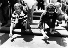 Steven Spielberg and George Lucas get their hand prints in cement at the historic Graumans Chinese Theater
